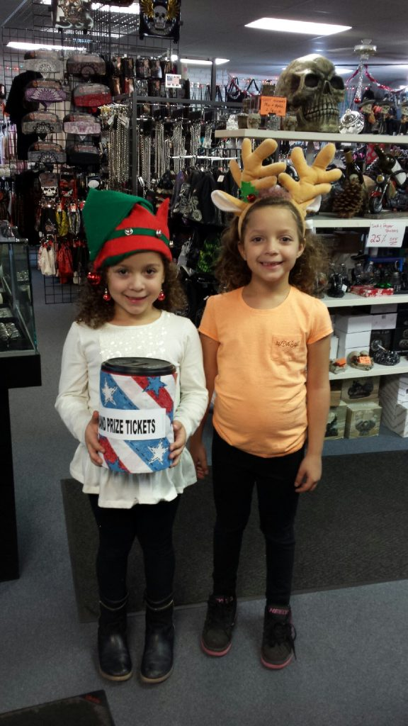 Little Elf and Little Reindeer pull the winning tickets